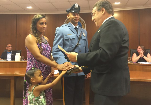 Mayor David Maffei swears in Police Officer Steve Austin who is joined by his wife and one of his two daughters.
