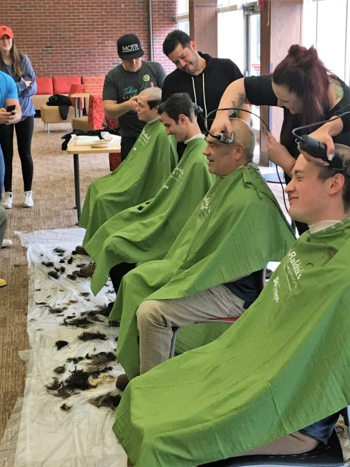 Gusciora Shaves Head for Pediatric Cancer Research