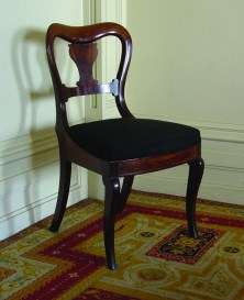 This set of 12 mahogany balloon-back chairs, ca. 1835, are attributed to the workshop of Duncan Phyfe.