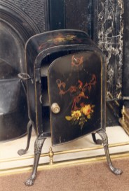 This painted tin plate warmer stood laden with heavy plates for so many years that it wore footprints in the marble hearth.