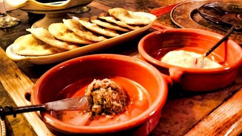 Tortas de aceite, served with garlic tapenade