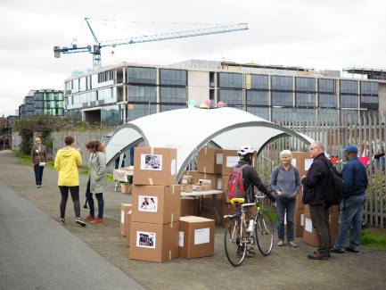 Open air booth with discussion between residents and organisers of canal-side proposals