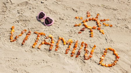Vitamin D spelled out on a beach