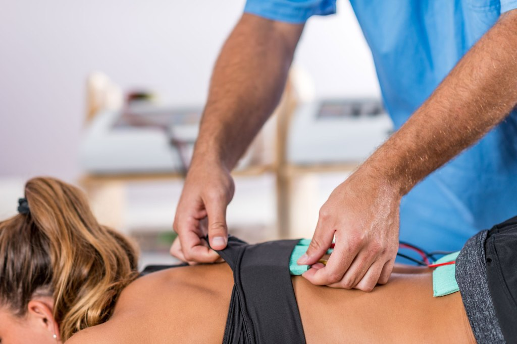 electric stim chiropractic therapy