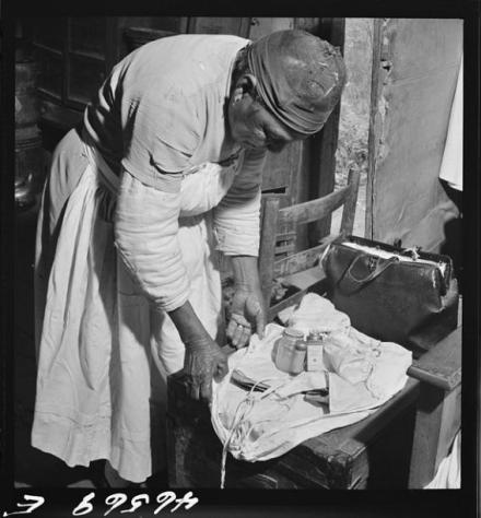 A Midwife wrapping her kit, preparing to leave for a delivery.