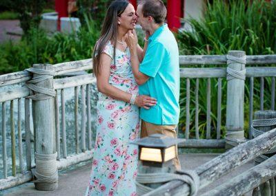 couple posing for maternity portraits at the Pagoda Garden in Norfolk, VA