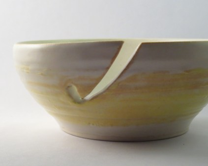 Matte-finished yarn bowl in soft cream and yellow colours, featuring custom cutout to catch yarn (SOLD)