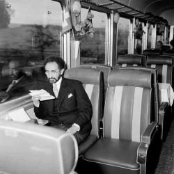 Emperor HaileSelassie I of Ethiopia takes a train ride while on an official visit in Switzerland ...