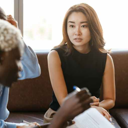 young asian woman explaining business strategy to colleague