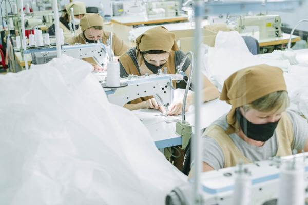 Women sewing in textile mile