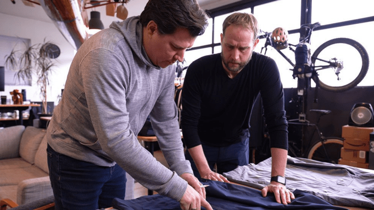 Woolly Founders Looking At Clothes