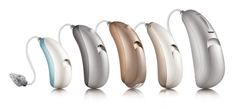 5 receiver-in-canal hearing aids of different sizes and colors