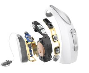 Single Starkey Livio Edge AI hearing aid shown as 5 different layers showcasing the technology inside