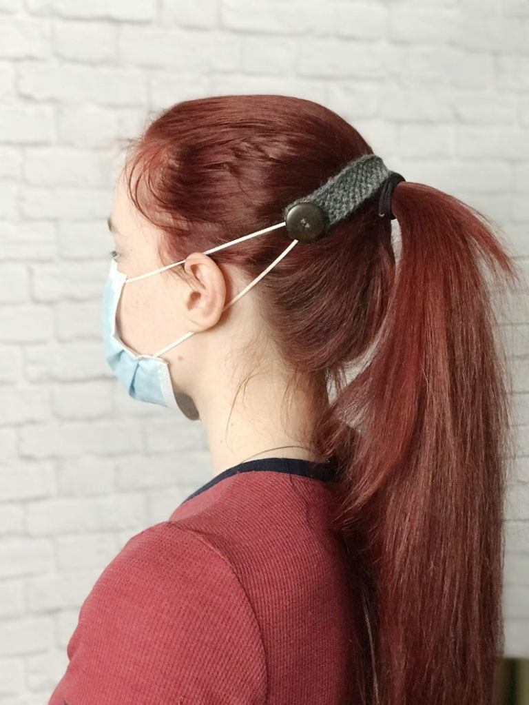 girl wearing medical facemask with a mask holder extender