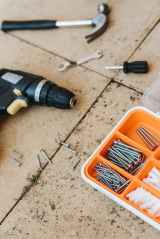 repair tools in container with hammer and screwdriver