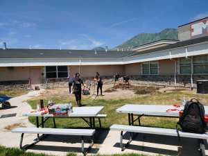 imagine learning service project cleaning courtyard at merit academy