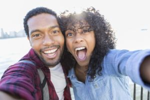 african american couple smiling for selfie