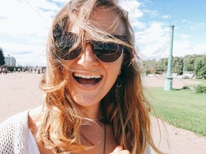 Happy woman in sunglasses and long hair