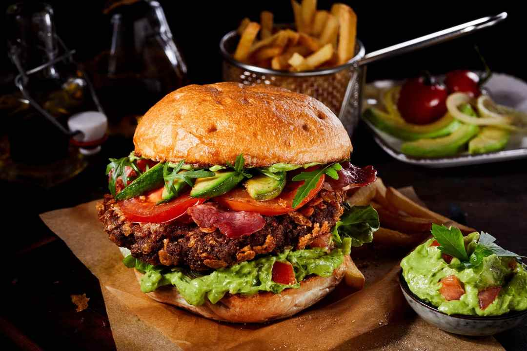 South of the Border Burger with Guacamole. Delicious burger with fresh avocado and guacamole