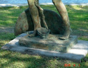 The Tarpon Springs famous manatees and sponges with the mermaid sculpture