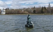 The city pond, with a mermaid in the foreground.