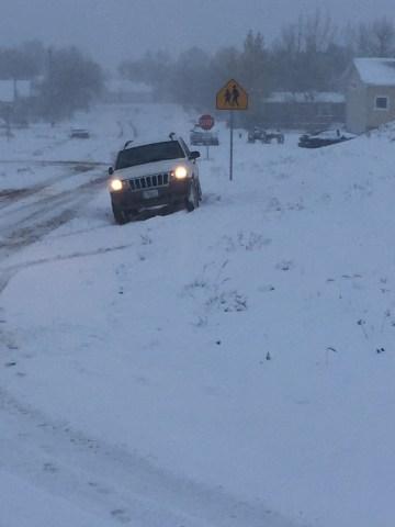 car stuck in a drift of snow