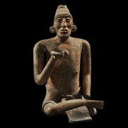 JAINA FIGURE OF A SEATED DIGNITARY