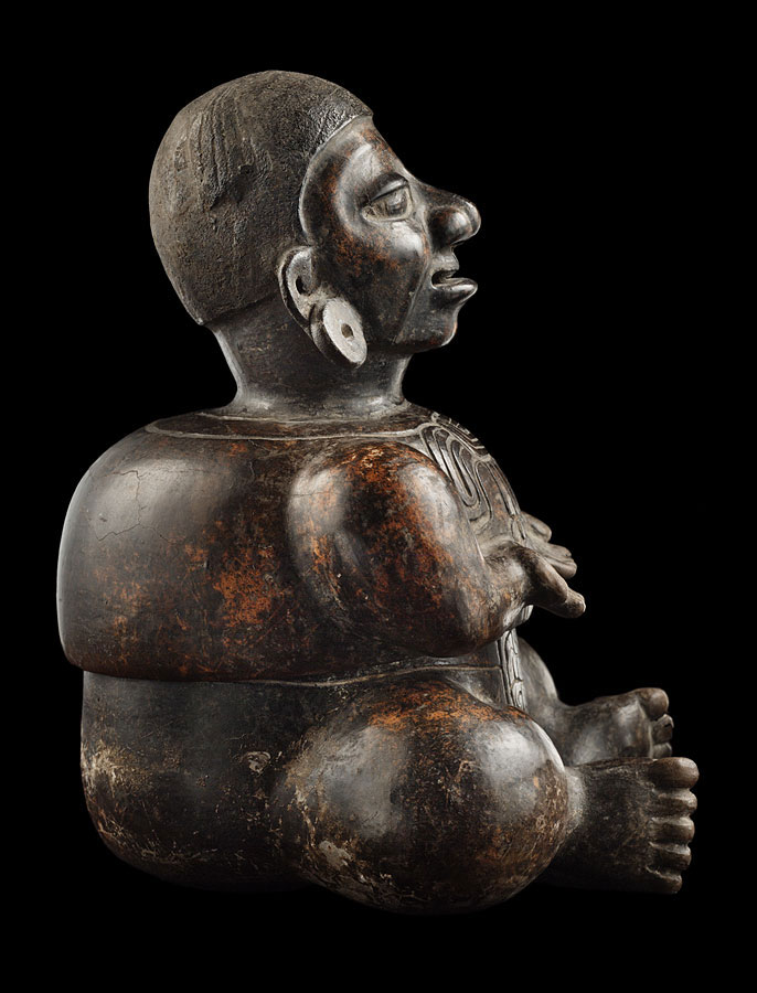 black effigy figure vessel side