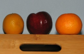 apple and oranges with extra flashlight to compensate for shadow