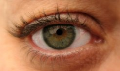 close up of woman's eye -- brown and green in the middle with blue edges
