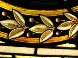 macro photo of row of leaves in stained glass window