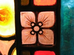 macro photo of square-shaped flower in stained glass window