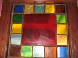colorful stained glass window with an etched pattern