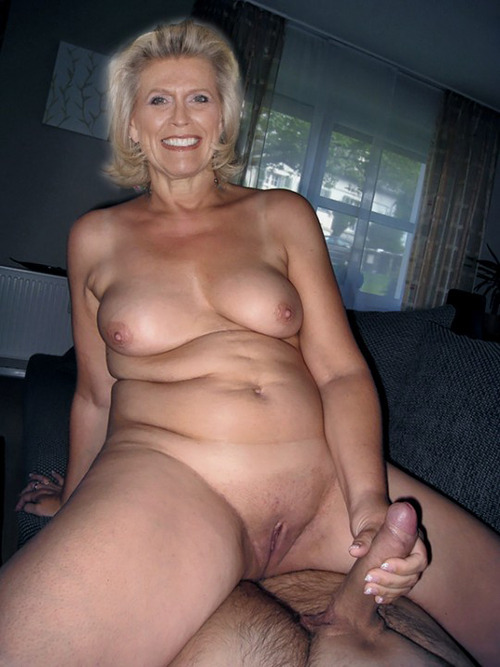 Nude slut holding cock for