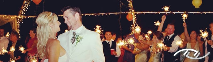 Brent & Elana enjoying their First Dance as their guests are encircling the dance floor while holding sparklers. Their Wedding Entertainment Director® was Peter Merry with MERRY WEDDINGS. (Photo Credit: Bauman Photographers)