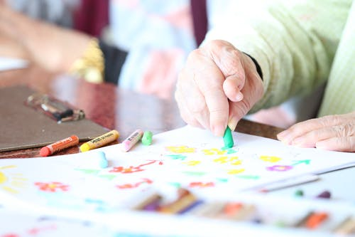 nursing home resident coloring with crayons