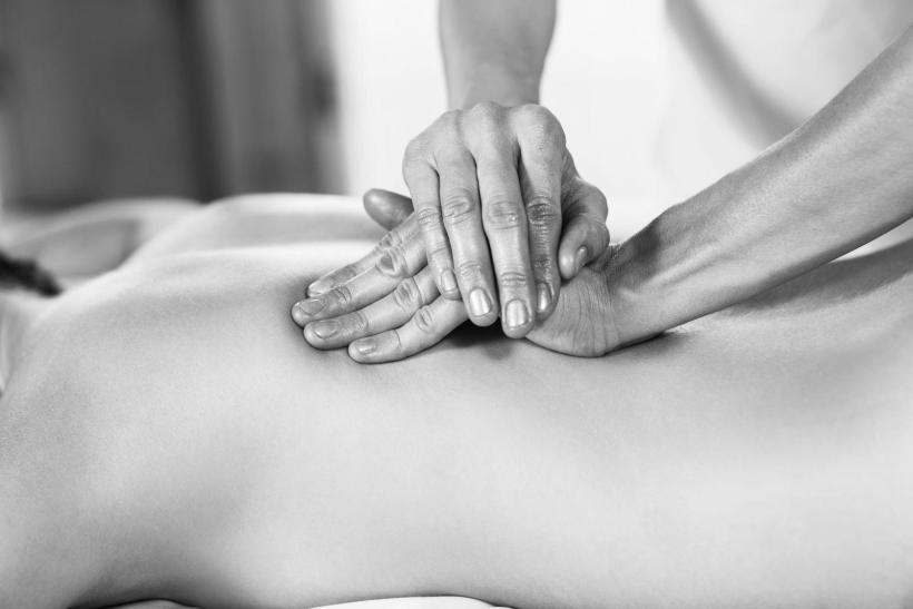 46714588 - beautiful young woman getting back massage at spa