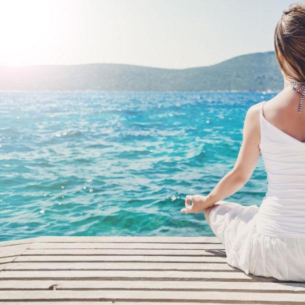 37559368 - woman meditating at the sea