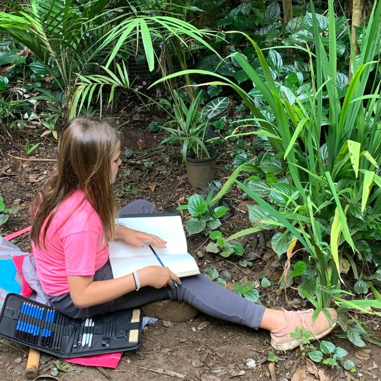 A middle school student at Seabury Hall in the Merwin garden