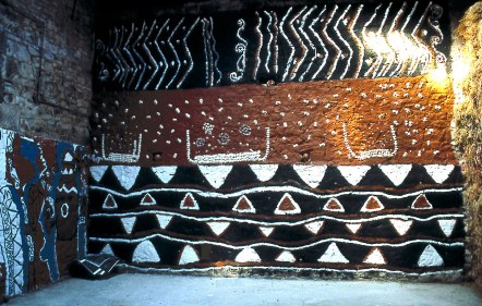 Toro's barn was plastered with cow dung in the traditional Nigerian style, painted, and inset with cowrie shells.