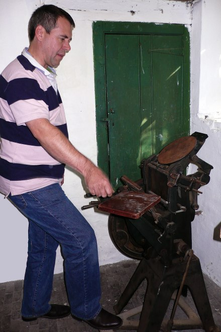 Bill Davis gifting his mother's printing press to the Merz Barn project