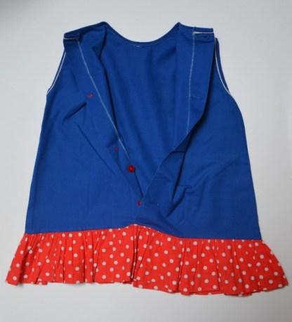 Petite robe vintage bleu roi à volants rouge et pois blanc pour bébé. Ni marque, ni étiquette