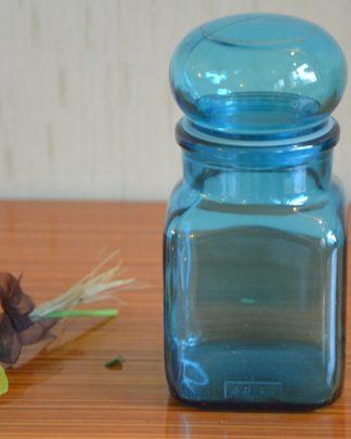 Pot d'apothicaire de la marque Ariel en verre bleu, bouchon rond.