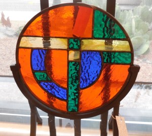 Sunset colors flood this stained glass suncatcher by Linda Birks