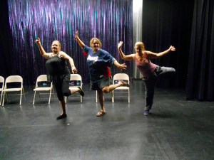 Virgin Valley Theatre Group and Fly Willie workshop participants Patty Amore, Teri Nehrenz and Roberta Brocius show a great deal of enthusiasm as the Fly Willie/Actor's workshop moves onto the stage.  The actor's and writer/director/choreographer Dan Nielsen agree that the stage lends a whole new feel to the workshops. Photo by Teri Nehrenz