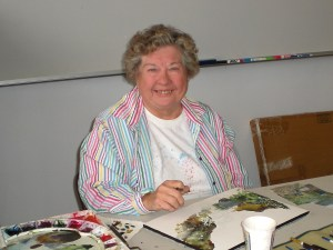 Joyce Burke with her watercolors. Photo by Susan Holladay.