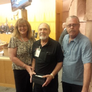 ‎RTC gathered on Oct. 9 to recognize one of Mesquite's drivers at their meeting. From left to right is Deb Dauenhauer, Executive Director, Bob Peterson and Mike Jackson, Assistant Executive Director. Submitted photo.