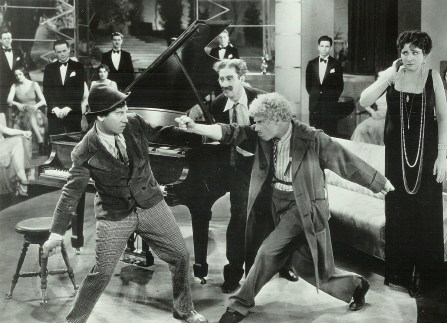 4. The Marx brothers in Animal Crackers as Margaret Dumont  looks on