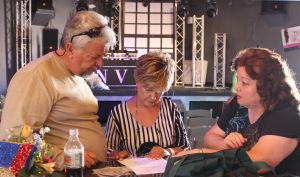 From left to right, Larry LeMieux, Geni Barton and Cindi Delaney go over the script and events prior to last Saturday's Gala. Photo by Jim Lavender.