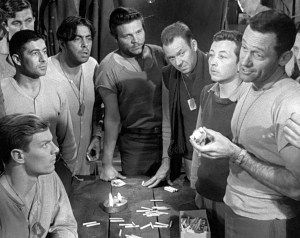 Cast of Stalag 17. Peter Graves (seated), William Holden (right), and Richard Erdman (third from right) -Paramount Pictures